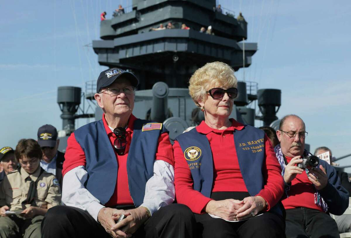 Reba Harvey Watson, center right, and her husband Bill Watson, center left, listen to speakers during a Pearl Harbor Day ceremony aboard the Battleship Texas Saturday, Dec. 5, 2015, in La Porte.