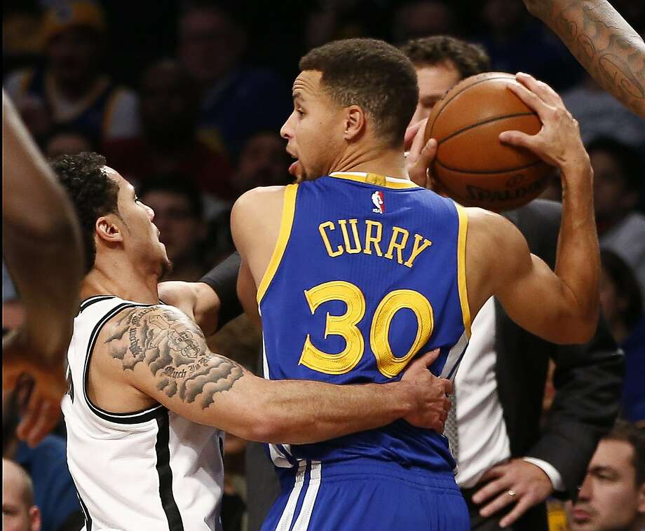 Brooklyn Nets guard Shane Larkin, left, defends as Golden State Warriors guard Stephen Curry (30) looks to pass in the first half of an NBA basketball game, Sunday, Dec. 6, 2015, in New York. (AP Photo/Kathy Willens) Photo: Kathy Willens, Associated Press