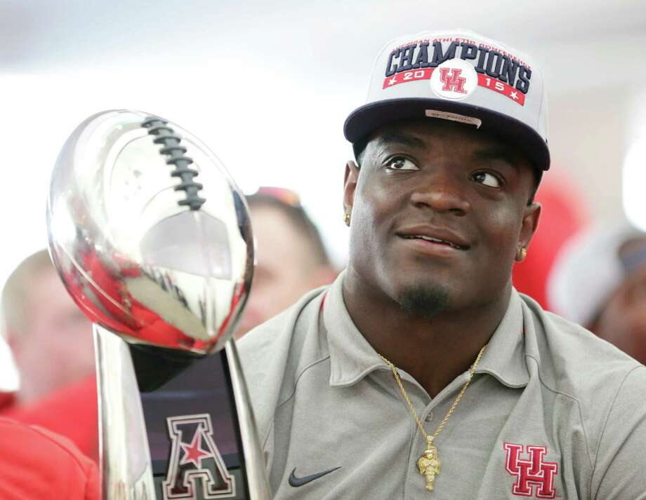 Linebacker Matt Adams was keeping one eye on the bowl selection show and another on the American Athletic Conference championship trophy Sunday. Photo: Jon Shapley, Staff / © 2015  Houston Chronicle