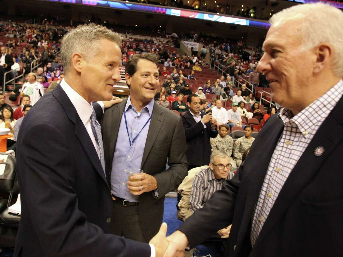Head Coach Gregg Popovich, right, of the San Antonio Spurs greets Head Coach Brett Brown, left, of the Philadelphia 76ers at the Wells Fargo Center in Philadelphia on Monday, Nov. 11, 2013. (Charles Fox/Philadelphia Inquirer/MCT)