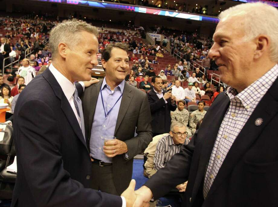 Head Coach Gregg Popovich, right, of the San Antonio Spurs greets Head Coach Brett Brown, left, of the Philadelphia 76ers at the Wells Fargo Center in Philadelphia on Monday, Nov. 11, 2013. (Charles Fox/Philadelphia Inquirer/MCT) Photo: Charles Fox, MBR / McClatchy-Tribune News Service / Philadelphia Inquirer
