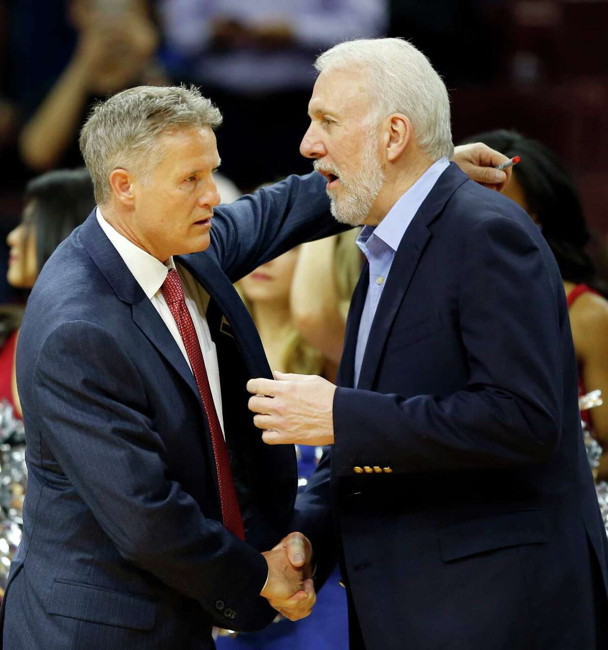 Philadelphia 76ers Head Coach Brett Brown meets San Antonio Spurs Head Coach Gregg Popovich before the two teams played each other on Monday, Dec. 1, 2014, at Wells Fargo Center in Philadelphia. (Yong Kim/Philadelphia Inquirer/TNS)