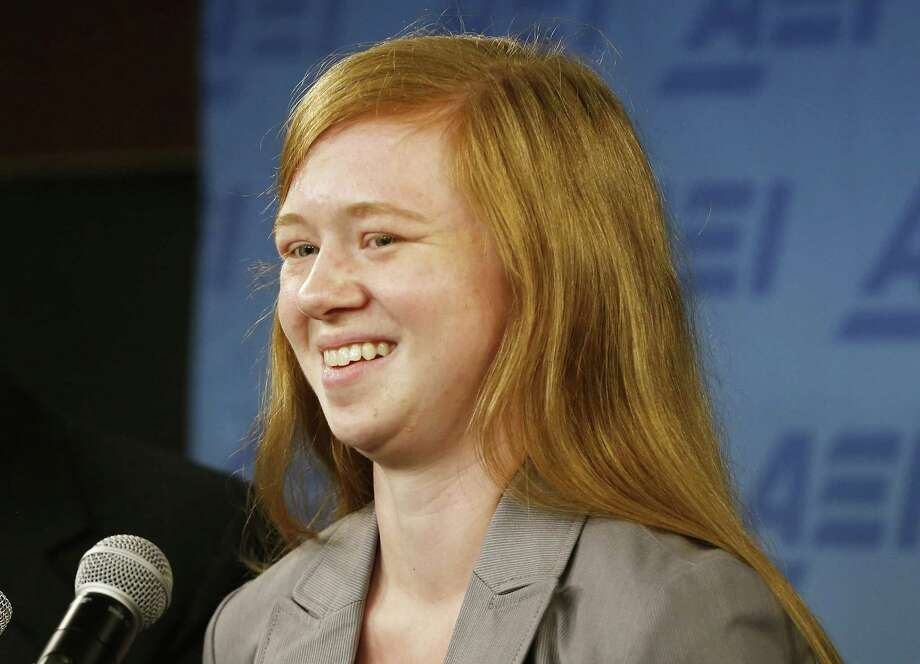 FILE - In this June 24, 2013, file photo, Abigail Fisher, who sued the University of Texas when she was not offered a spot at the university's flagship Austin campus in 2008, speaks in Washington. Consideration of race in college admissions is again in line of fire at the Supreme Court, Wednesday, Dec. 9, 2015, for the second time in three years, in the case of Fisher, a white Texas woman who was rejected for admission at the University of Texas.  (AP Photo/Charles Dharapak, File) ORG XMIT: WX101 Photo: Charles Dharapak / AP