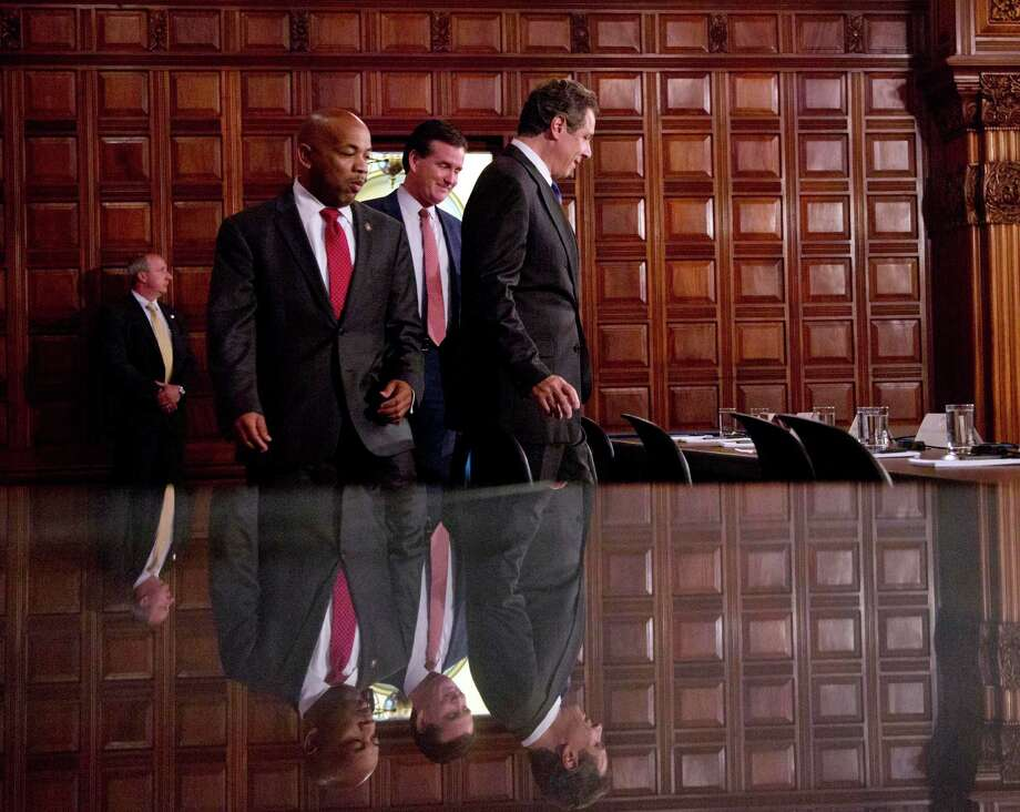 FILE - In this June 25, 2015, file photo, Assembly Speaker Carl Heastie, D-Bronx, left, Senate Majority Leader John Flanagan, R-Smithtown, center, and Gov. Andrew Cuomo arrive for a news conference in the Red Room at the Capitol in Albany, N.Y. Many ideas have been floated as ways to combat corruption in New York state government, but it remains to be seen whether the conviction of ex-state Assembly Speaker Sheldon Silver will prompt state leaders to find the will to pass them. (AP Photo/Mike Groll, File) ORG XMIT: NYR701 Photo: Mike Groll / AP