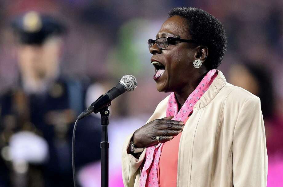 LANDOVER, MD - OCTOBER 06:  Sharon Jones sings the national anthem before a game between the Washington Redskins and the Seattle Seahawks at FedExField on October 6, 2014 in Landover, Maryland.  (Photo by Patrick Smith/Getty Images) ORG XMIT: 507883747 ORG XMIT: MER2015112819264106 Photo: Patrick Smith / 2014 Getty Images