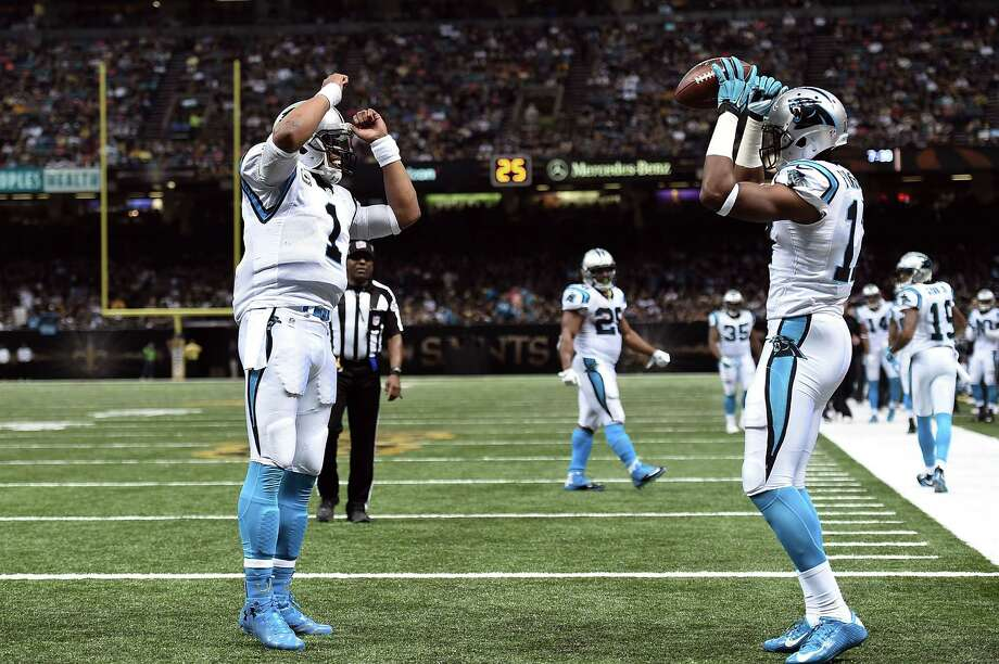 NEW ORLEANS, LA - DECEMBER 06:  Cam Newton #1 celebrates a touchdown with Devin Funchess #17 of the Carolina Panthers during the third quarter of a game against the New Orleans Saints at the Mercedes-Benz Superdome on December 6, 2015 in New Orleans, Louisiana.  (Photo by Stacy Revere/Getty Images) ORG XMIT: 587436323 Photo: Stacy Revere / 2015 Getty Images