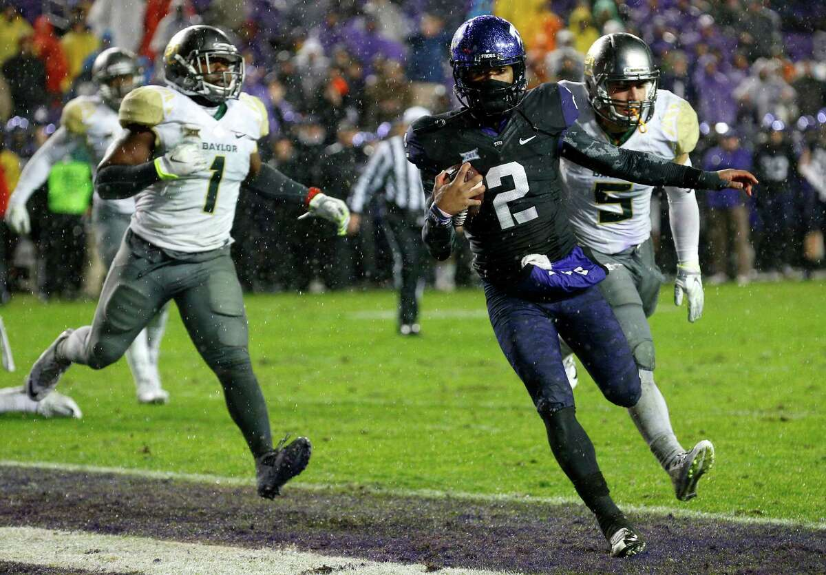 TCU quarterback Trevone Boykin (2) scores a touchdown in the first overtime against Baylor at Amon G. Carter Stadium in Fort Worth, Texas, on Friday, Nov. 27, 2015. The host Horned Frogs won, 28-21, in double overtime. (Richard W. Rodriguez/Fort Worth Star-Telegram/TNS)