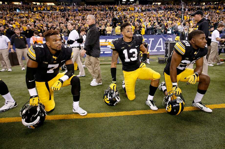 INDIANAPOLIS, IN - DECEMBER 05:  Sean Draper #7, Greg Mabin #13 and Maurice Fleming #28 of the Iowa Hawkeyes react after losing to the Michigan State Spartans in the Big Ten Championship at Lucas Oil Stadium on December 5, 2015 in Indianapolis, Indiana.  (Photo by Joe Robbins/Getty Images) Photo: Joe Robbins, Getty Images