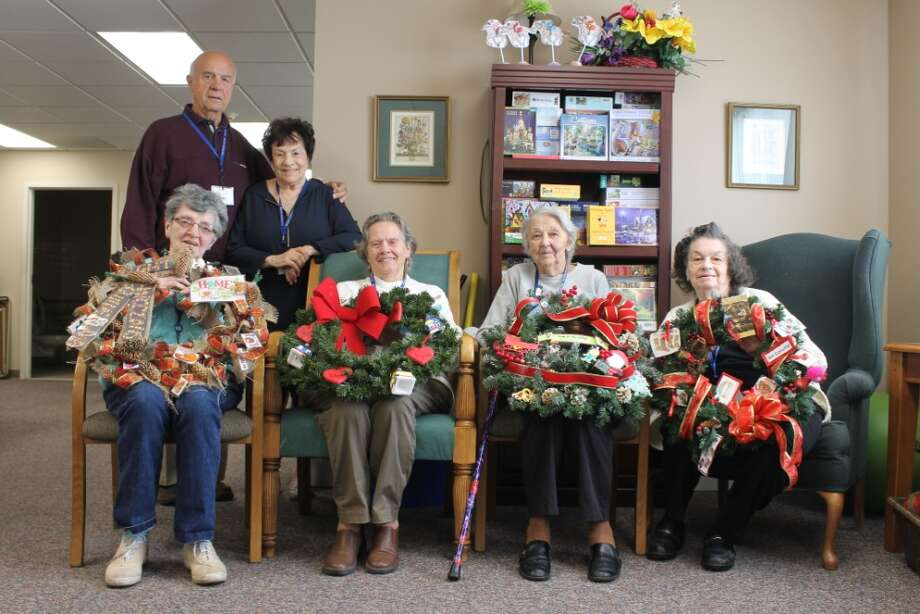 """Bright Horizons Adult Day Care Program members and staff created holiday wreaths after the Times Union announced """"Circles of Caring."""" Each Bright Horizons site -- Colonie, Guilderland, Latham and Clifton Park -- creating their own wreath but also with a common theme- """"Home for the Holidays,"""" which embodies the mission of Bright Horizons to help people remain in their own homes or with family. The project begins with a wreath-making contest and ends with delivery to places such as nursing homes and homeless shelters, with clients who would enjoy having one of the entries for their own."""