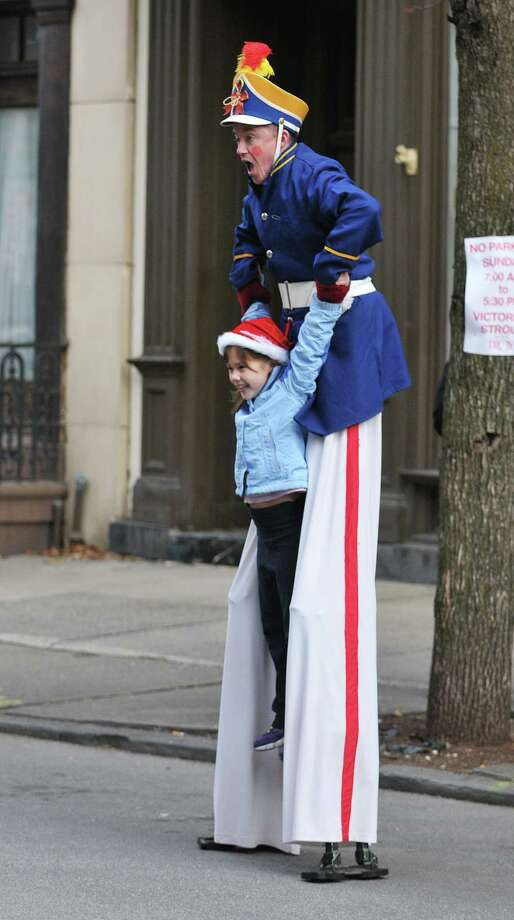 Ana Murray, 7, is lifted up by Sean Fagan of Seano's Circus Theatrics during the 33rd annual Troy Victorian Stroll on Sunday, Dec. 6, 2015, in Troy, N.Y.  (Paul Buckowski / Times Union) Photo: PAUL BUCKOWSKI / 10034353A