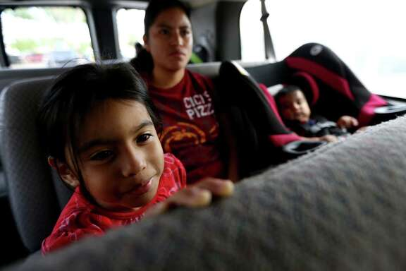 Aura Velasco, daughter Karen Perez and son Eliazar Velasquez catch a ride to the market on the Magic Bus.