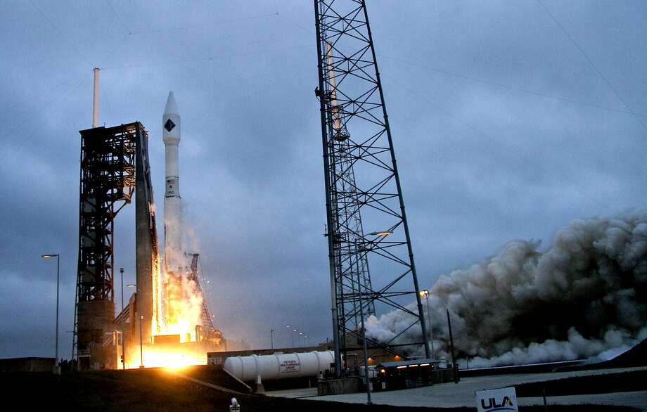 A United Launch Alliance Atlas V rocket lifts off from launch complex 41 at the Cape Canaveral Air Force Station, Sunday, Dec. 6, 2015, in Cape Canaveral, Fla. The rocket was delivering supplies to the International Space Station.  (AP Photo/John Raoux) Photo: John Raoux, Associated Press