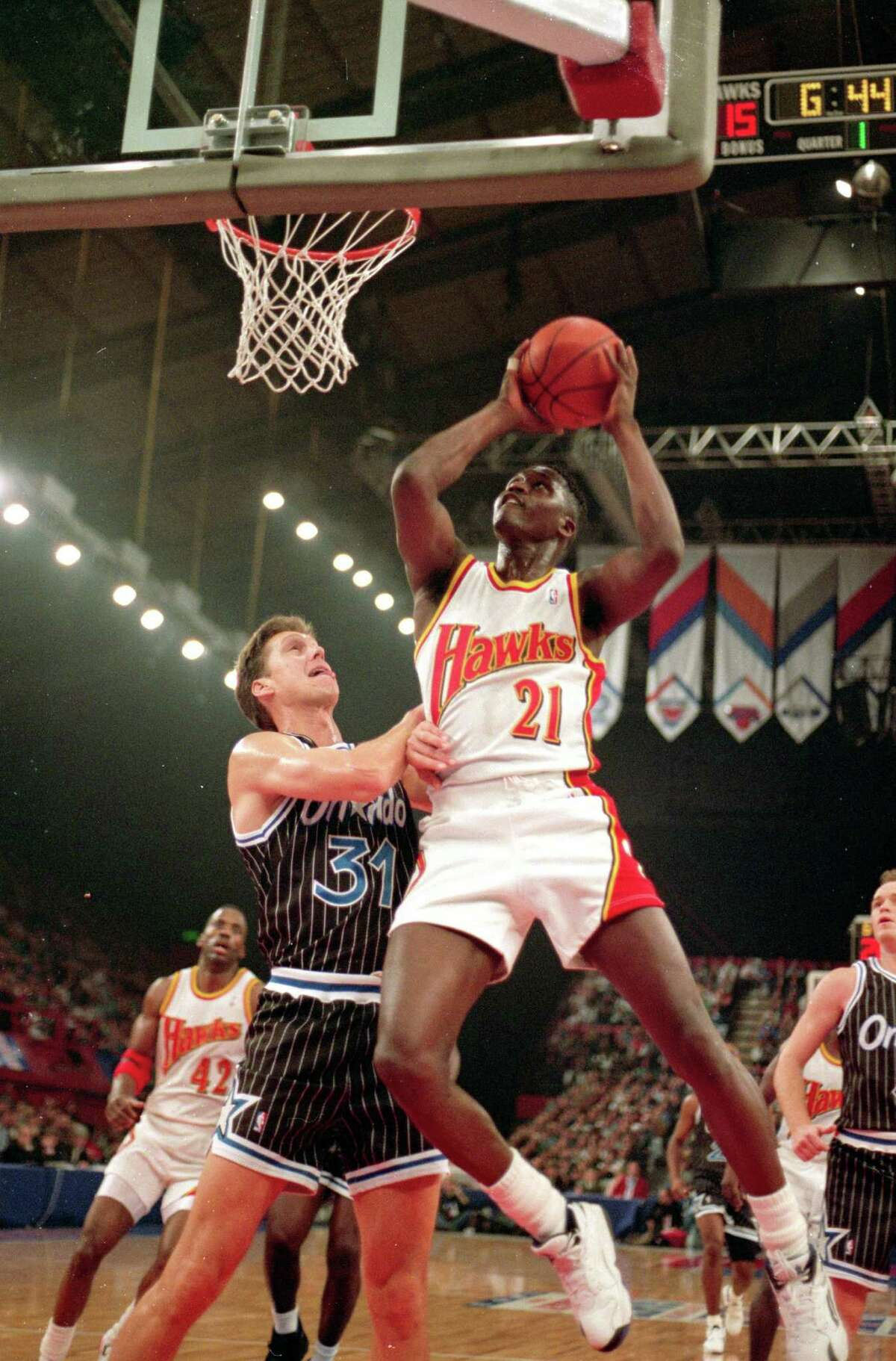 Dominique Wilkins of the Atlanta Hawks drives inside for a shot during a preseason game against the Orlando Magic at the Wembley Stadium in London, England, on Oct. 31, 1993.