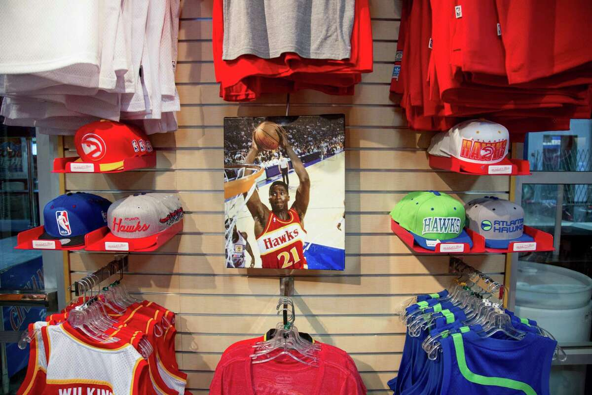 Atlanta Hawks memorabilia, featuring a photo of former star Dominique Wilkins, is shown inside the Hawks Shop inside the CNN Center, which houses the Philips Arena on Sept. 9, 2014.