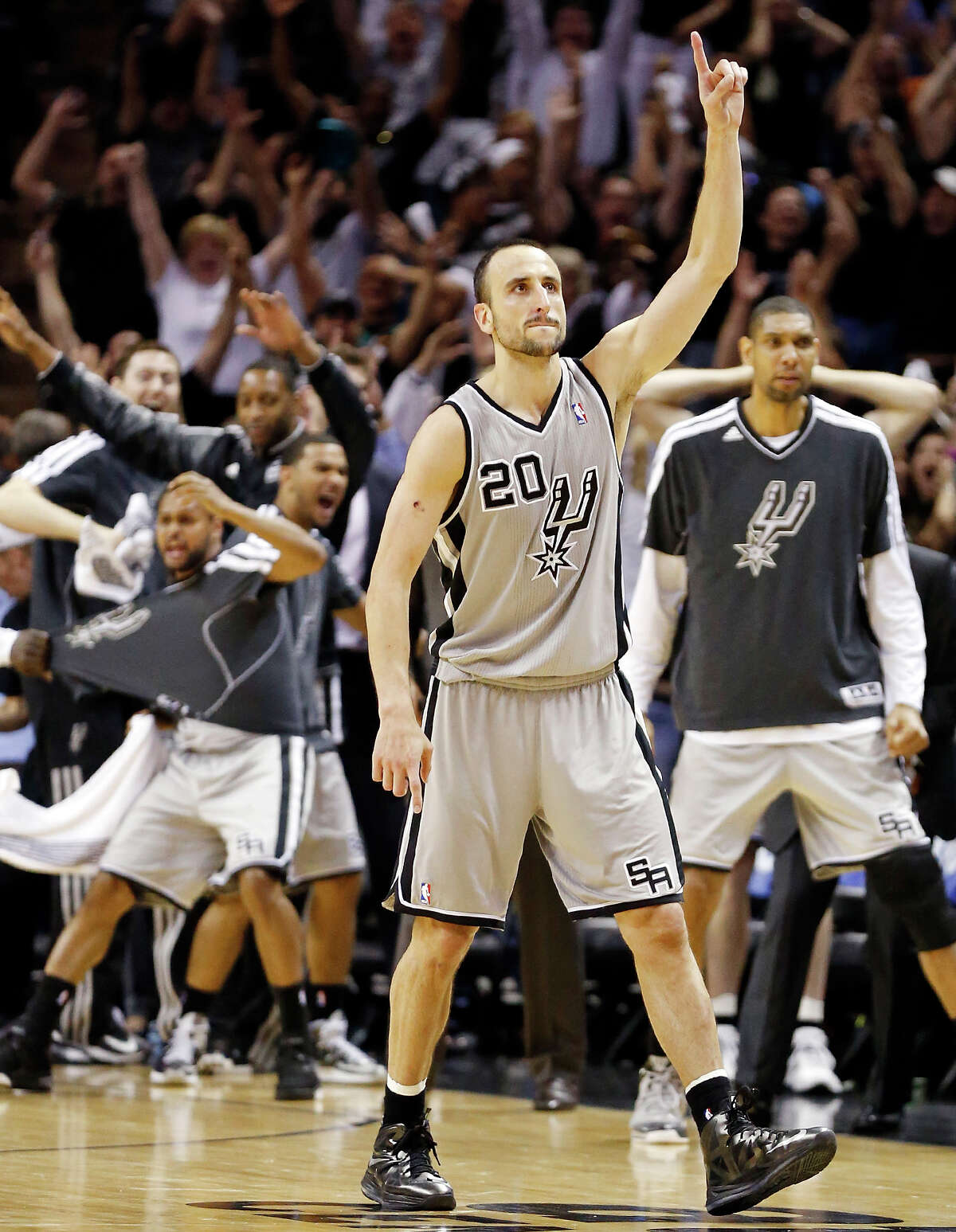 Spurs' Manu Ginobili reacts after making a 3-pointer late in double overtime of Game 1 in the Western Conference semifinals against the Golden State Warriors.