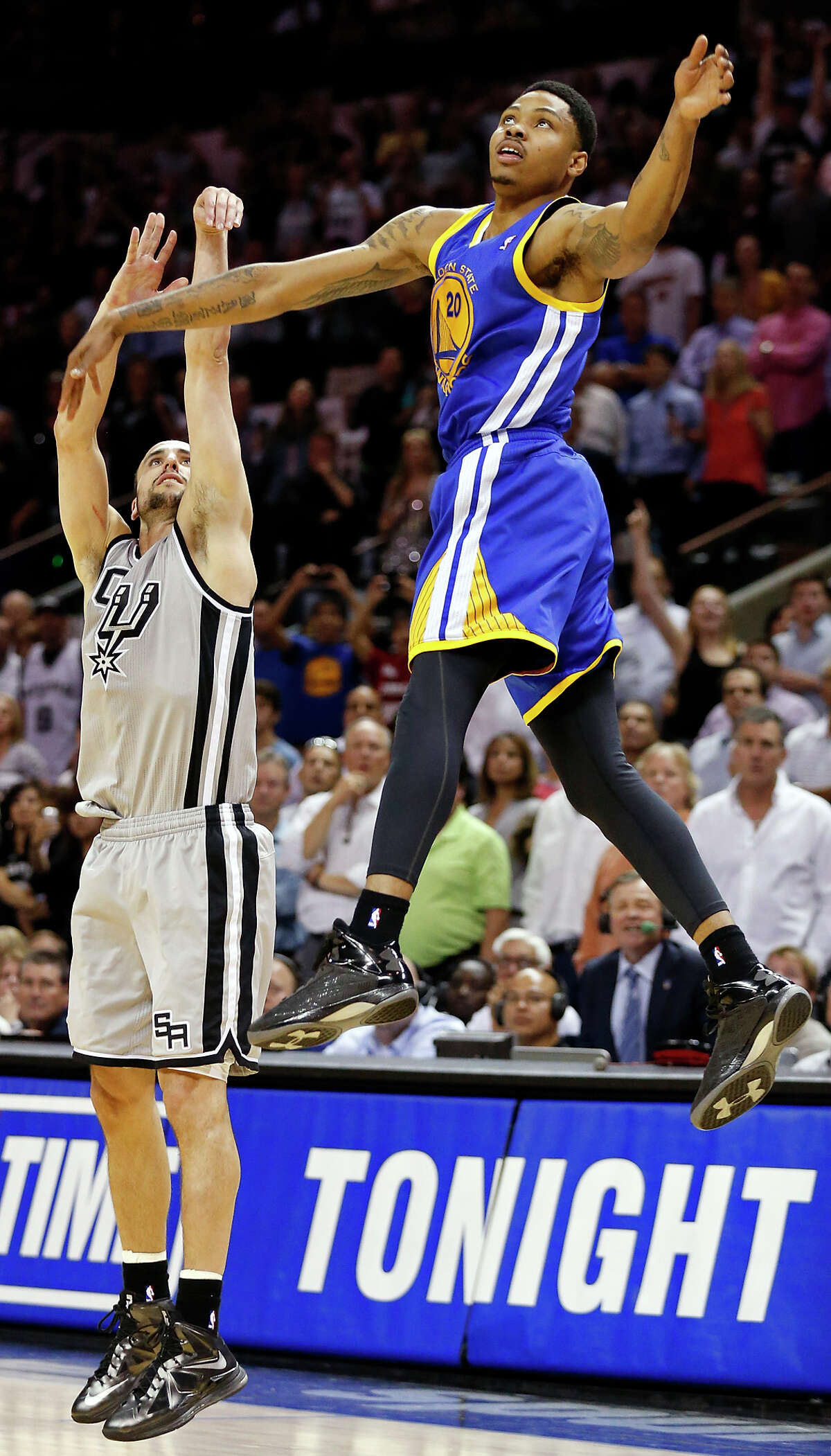 Spurs' Manu Ginobili watches his game-winning 3-pointer as he is defended by Golden State Warriors' Kent Bazemore late in double overtime.