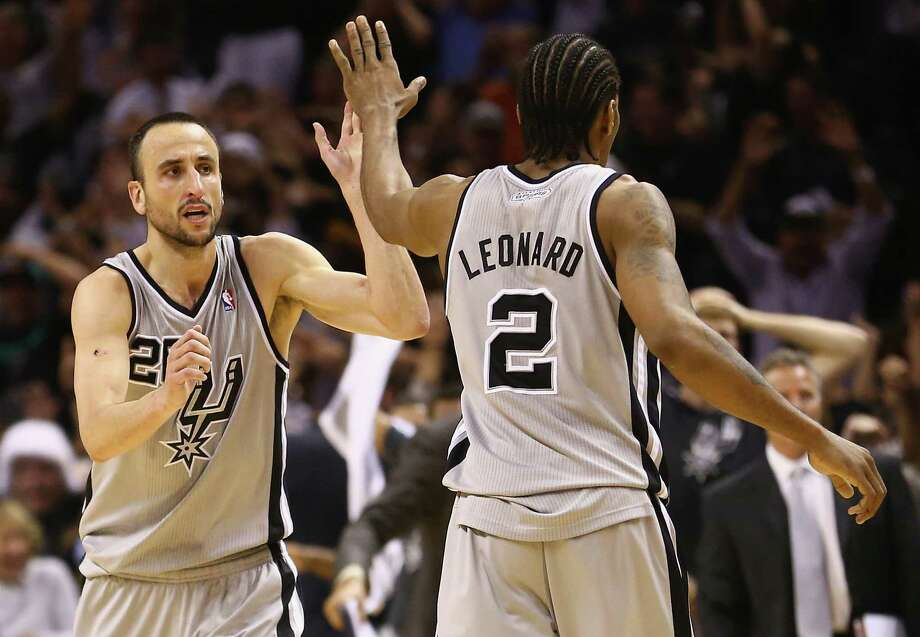 Manu Ginobili of the Spurs celebrates with Kawhi Leonard after hitting the game-winning shot against the Golden State Warriors in double overtime during Game 1 of the 2013 Western Conference semifinals. Photo: Ronald Martinez /Getty Images / 2013 Getty Images