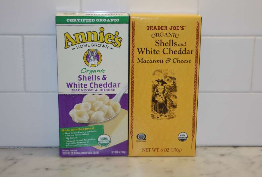 Organic Shells and White Cheddar: Annie's vs. Trader Joe'sIngredients: Basically the same except Annie's contains cream.Taste: Annie's seems a little creamier.Prices: $2.49 at Whole Foods, $1.29 at TJ's.The verdict: Annie's could very well be making TJ's mac and cheese with a slightly different recipe than its own product. Photo: Amy Graff