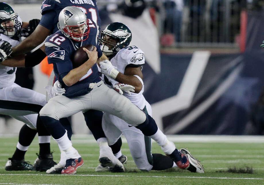 Philadelphia Eagles linebacker Brandon Graham (55) sacks New England Patriots quarterback Tom Brady (12) during the second half of an NFL football game, Sunday, Dec. 6, 2015, in Foxborough, Mass. (AP Photo/Charles Krupa)  ORG XMIT: FBO123 Photo: Charles Krupa / AP