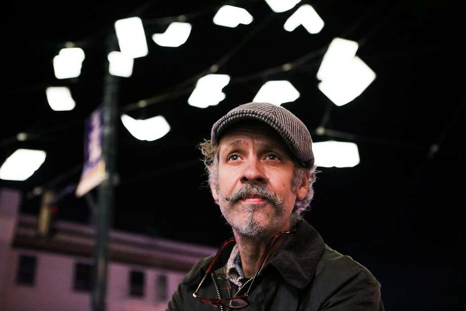"Artist Brian Goggin stands in front of his installation ""Language of the Birds"", in San Francisco, California on Thursday, December 3, 2015. Photo: Gabrielle Lurie, Special To The Chronicle"