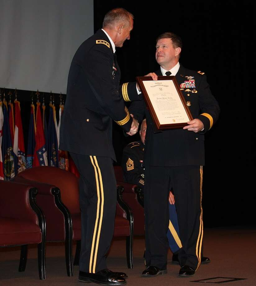 Mike Casey / Army Army Lt. Gen. Robert B. Brown, left, Combined Arms Center - Training commander, hands a certificate of promotion Mark J. O?Neil as O?Neil is promoted to major general during a ceremony at Fort Leavenworth, Kan., Friday.