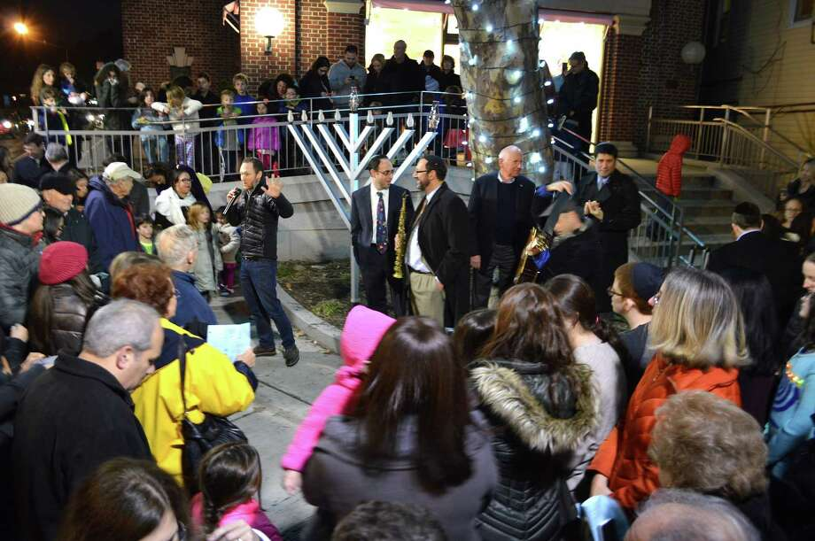 A crowd turned out Sunday evening for the menorah-lighting ceremony to mark the start of Hanukkah sponsored by the town's four Jewish congregations. Photo: Jarret Liotta / For Hearst Connecticut Media / Westport News