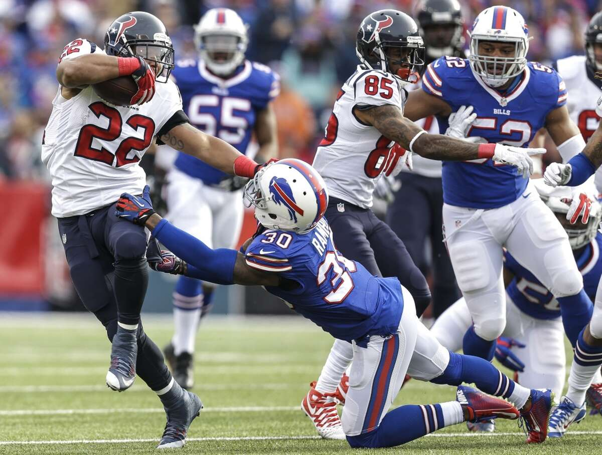 Houston Texans running back Chris Polk (22) runs past Buffalo Bills strong safety Bacarri Rambo (30) during the first quarter of an NFL football game at Ralph Wilson Stadium on Sunday, Dec. 6, 2015, in Orchard Park, N.Y. ( Brett Coomer / Houston Chronicle )