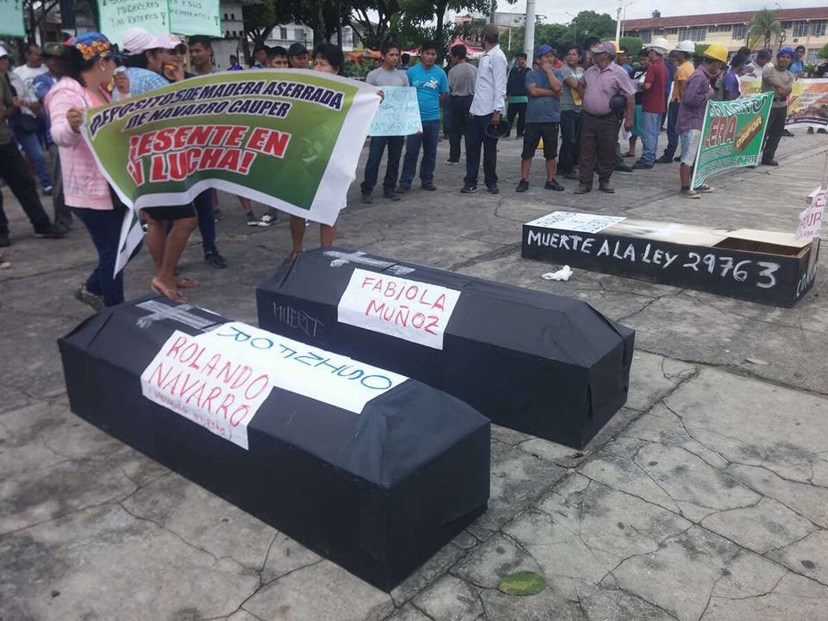 Coffins at a Nov. 23 protest in Iquitos Peru.Protesters put names on the coffins of Peruvian government officials who work for OSINFOR, the Peruvian agency in charge of reviewing export permits for wood.