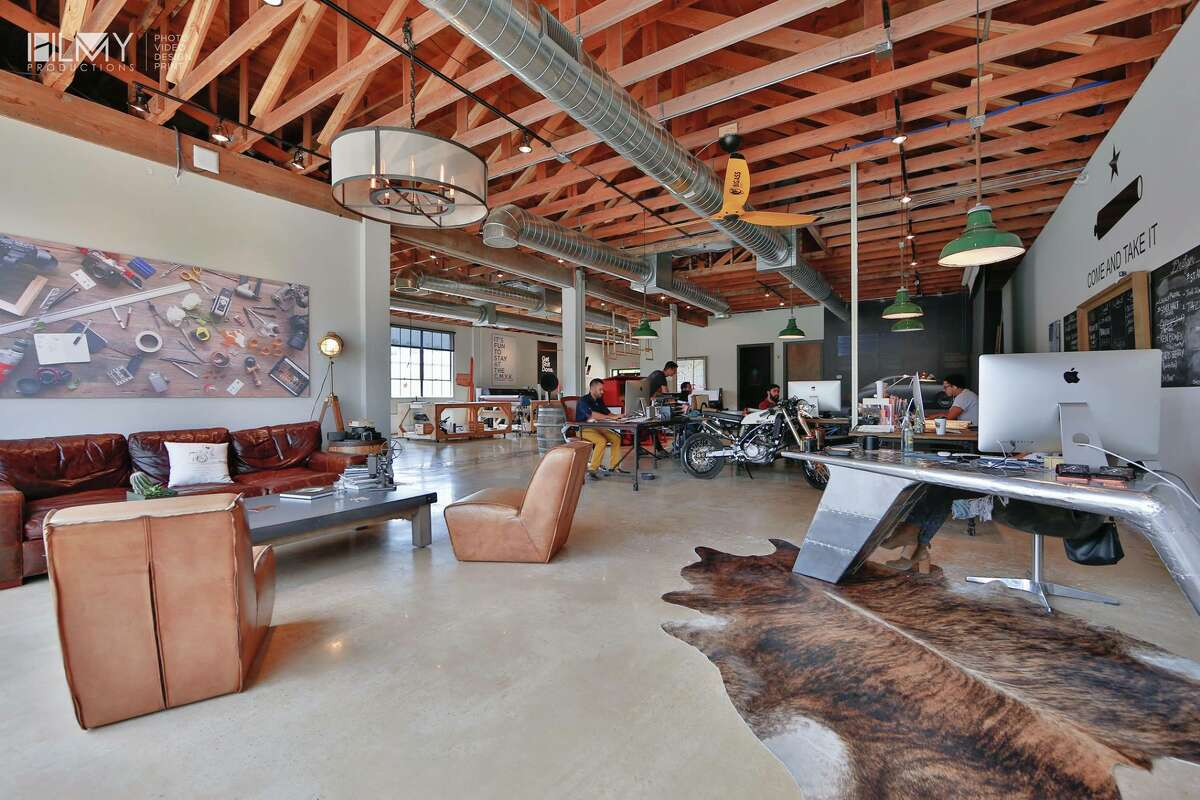 An airplane wing stands as a desk near the front of the 5,000 square-foot office.
