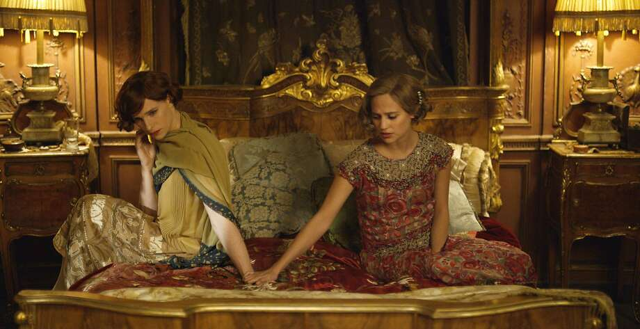 Eddie Redmayne (left) is Lili Elbe, who is transitioning to female, and Alicia Vikander is Lili's confused, ultimately supportive wife. Photo: Agatha A. Nitecka, Associated Press
