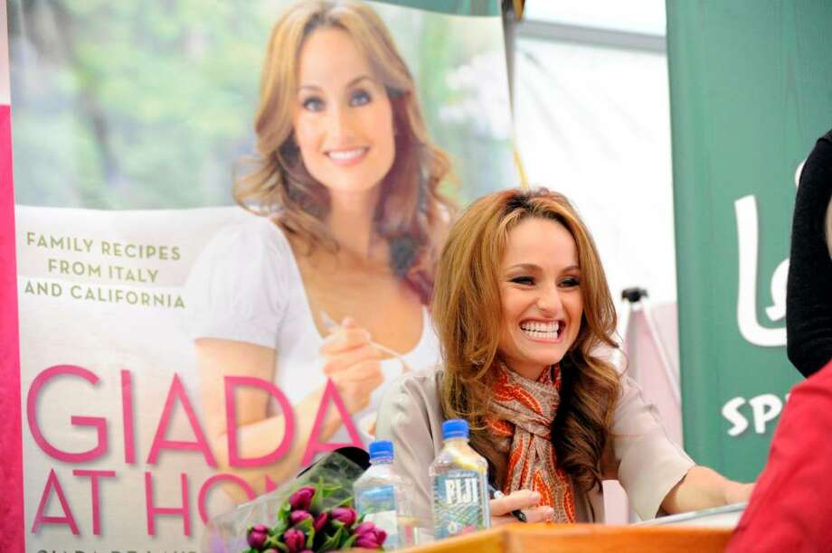 "Celebrity chef Giada De Laurentiis greets fans as she signs copies of her new book ""Giada at Home"" at Stew Leonard's in Norwalk, Conn., Wednesday evening March 31, 2010. Photo: Keelin Daly / Stamford Advocate"