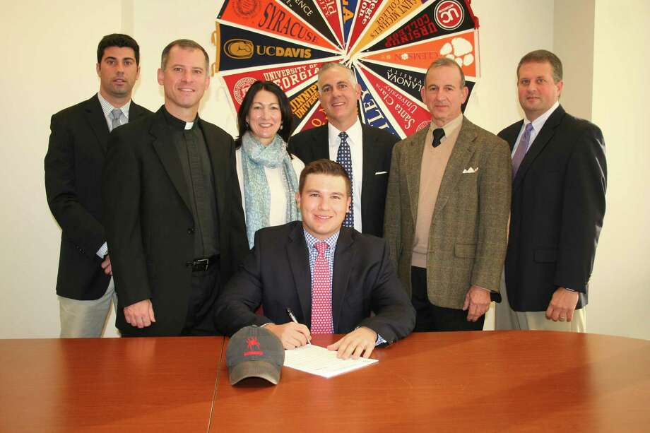 Fairfield Prep student-athlete Andrew Sciarretta signs his National Letter of Intent to attend the University of Richmond next fall on a golf scholarship. Sciarretta has been the No. 1 player on the Jesuits squad for the past four seasons. Photo: Contributed / Contributed / Connecticut Post
