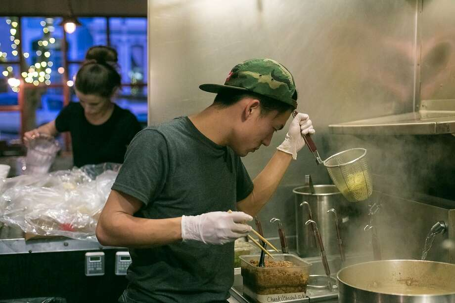 Ryo Ohokubo drains noodles for a ramen bowl at Iza Ramen. Photo: Jen Fedrizzi, Special To The Chronicle