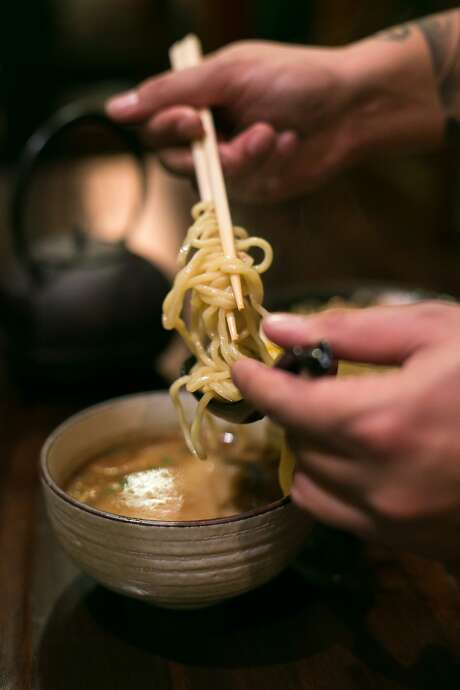 Tsukemen is a Japanese style of ramen and noodles are coated with the broth by dipping them at Iza Ramen. Photo: Jen Fedrizzi, Special To The Chronicle