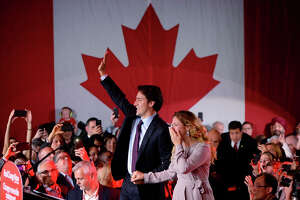 FOR USE AS DESIRED, YEAR END PHOTOS - FILE - Liberal leader Justin Trudeau waves to supporters with his wife, Sophie Gregoire, at the Liberal party headquarters in Montreal, Tuesday, Oct. 20, 2015. Trudeau, the son of late Prime Minister Pierre Trudeau, became Canada's new prime minister after beating Conservative Stephen Harper. (Sean Kilpatrick/The Canadian Press via AP, File) MANDATORY CREDIT