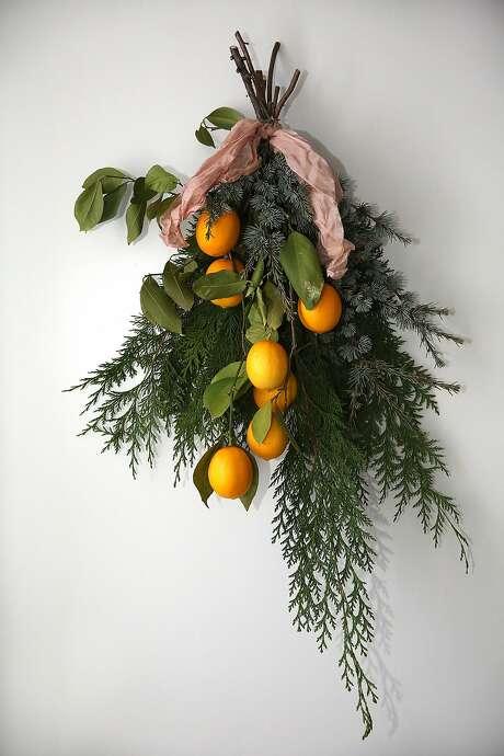 An arrangement by Natalie Bowen: greens and lemons. Photo: Liz Hafalia, The Chronicle
