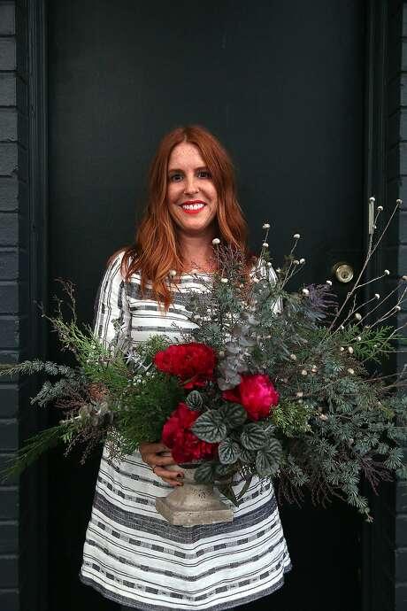 Designer Natalie Bowen with one of her arrangements in San Francisco. Photo: Liz Hafalia, The Chronicle