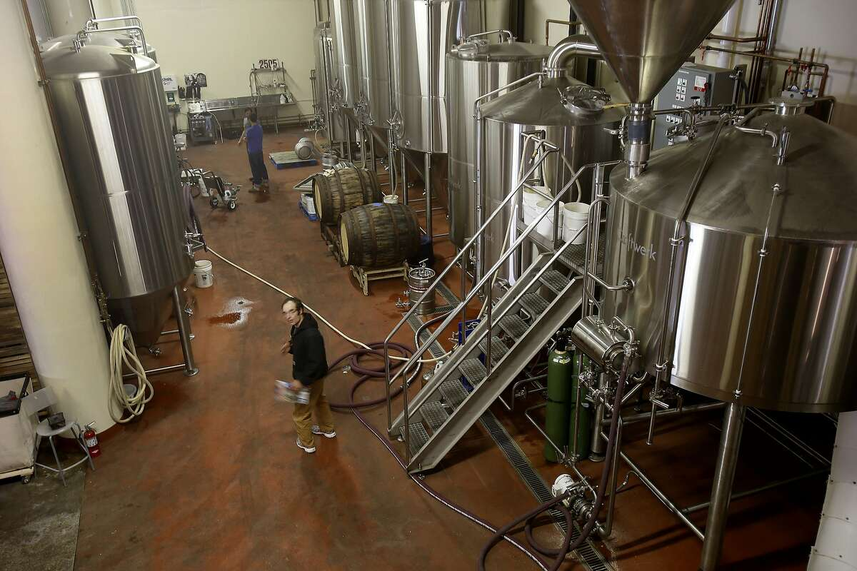 Looking down from the grain mill area of the brewery at the huge stainless steel tanks at Magnolia's year-old brewery.