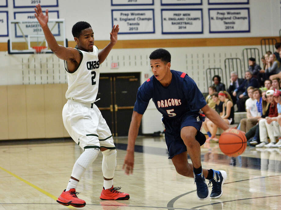 Greens Farms Academy junior Elvin Rodriguez takes on a Chase Collegiate defender in GFA's 67-52 win. Rodriguez was the leading scorer with 21 points and 6 assists. Photo: Contributed Photo / Westport News Contributed