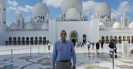 Rich Walker, of San Francisco, in front of the Sheikh Zayed Grand Mosque in Abu Dhabi.