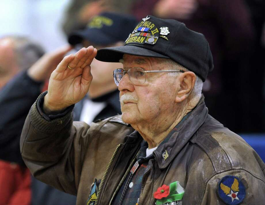 Alexander Sawchyn, 89, of Redding, a veteran of World War II, salutes during a Pearl Harbor Memorial service held at the War Memorial in Rogers Park Monday morning, Dec. 7, 2015. Photo: Carol Kaliff, Hearst Connecticut Media / The News-Times