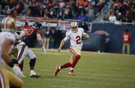 San Francisco 49ers quarterback Blaine Gabbert (2) runs to the end zone for a touchdown during the second half of an NFL football game against the Chicago Bears, Sunday, Dec. 6, 2015, in Chicago. (AP Photo/Charles Rex Arbogast)
