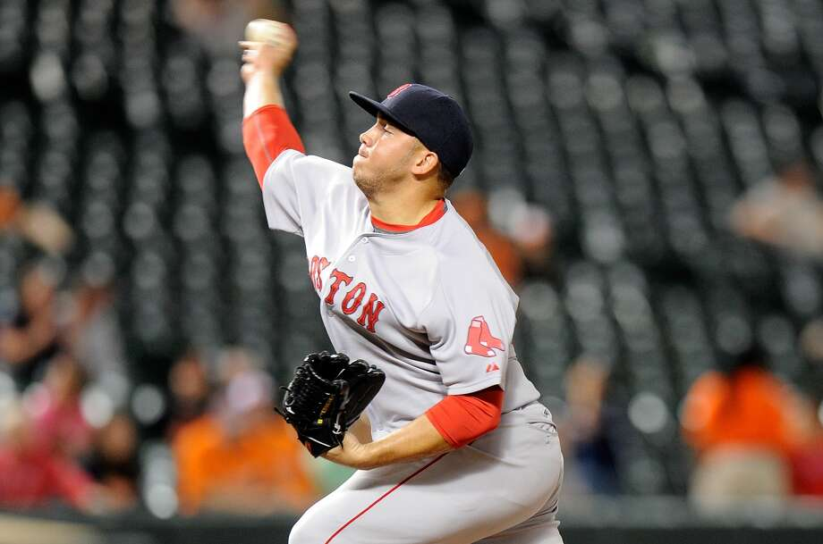 BALTIMORE, MD -  Jonathan Aro #65 of the Boston Red Sox pitches against the Baltimore Orioles at Oriole Park at Camden Yards on September 15, 2015 in Baltimore, Maryland. (Photo by G Fiume/Getty Images)