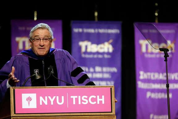 Actor Robert De Niro addresses the class of 2015, faculty, and guests during  New York University's Tisch School of the Arts commencement  ceremony,  Friday, May 22, 2015, in New York. De Niro, who quit high school to pursue an acting career, was the honored speaker at the raucous ceremony for 1,200 graduates at The Theater at Madison Square Garden.