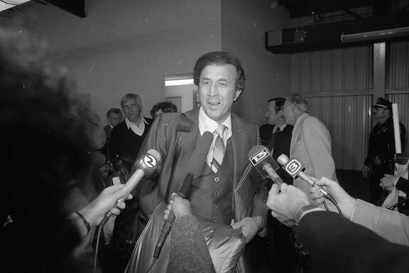 Fans greet the Oakland Raiders as they return to Oakland Airport after winning the Super Bowl January 1981  Tom Flores