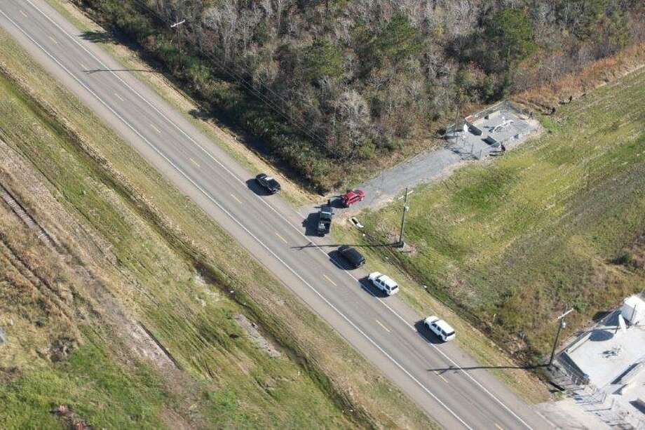 The Jefferson County Sheriff's Office Patrol Division and Helicopter, along with Beaumont PD K9 and Port Arthur Police K9 were involved in a manhunt on Dec. 7 after three subjects fled from a truck stuck in the front yard of a residence in Fannett. Photo: Courtesy Of Jefferson County Sheriff's Office