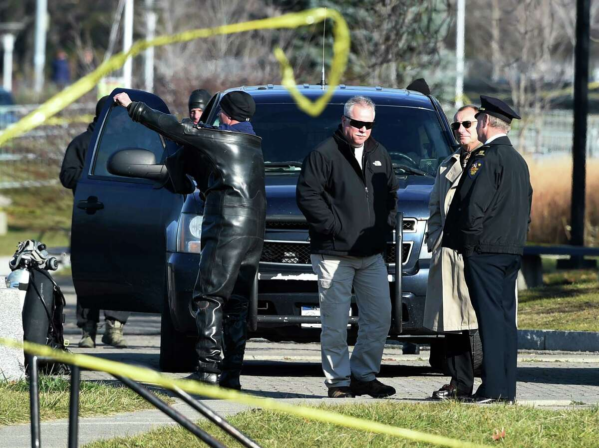 Troy Police Chief John Tedesco, second from right, observes the State Police Dive team getting ready to head in to the Hudson River to continue their search for Noel Alkaramla Monday, Dec. 7, 2015, between Watervliet and Troy, N.Y. (Skip Dickstein/Times Union)