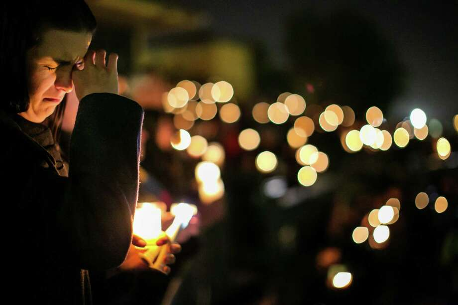 Community members attend a candlelight vigil at San Manuel Stadium in San Bernardino, California., a day after a shooting that killed 14 and wounded 21. A reader says that arming everyone in the country, as a means of self-defense, is not the answer to such traumatic events. Photo: Marcus Yam /McClatchy-Tribune News Service / Los Angeles Times