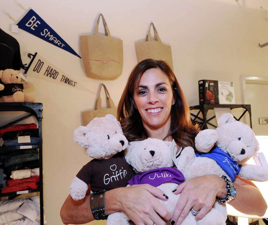 Lisa Lori, founder of Three Little Bears and #smilemore campaign, in her store, The Perfect Provenance, in Greenwich, Conn., Tuesday, Dec. 1, 2015. Lori's organization raises money that is donated to Operation Smile, an ogranization that facilitates the surgical repair of facial deformities in children throughout the world. Lori's three sons were born with a congenital facial deforminity that was surgically repaired by Dr. Ronald Zuker, a pediatric plastic surgeon, who is a surgical volunteer for Operation Smile. The Lori family was so grateful with Dr. Zuker's successful surgery that they started the Three Little Bears, named Luke, Griffin and Zachary, after the Lori boys and sell the bears to raise money for Operation Smile. Photo: Bob Luckey Jr. / Hearst Connecticut Media / Greenwich Time