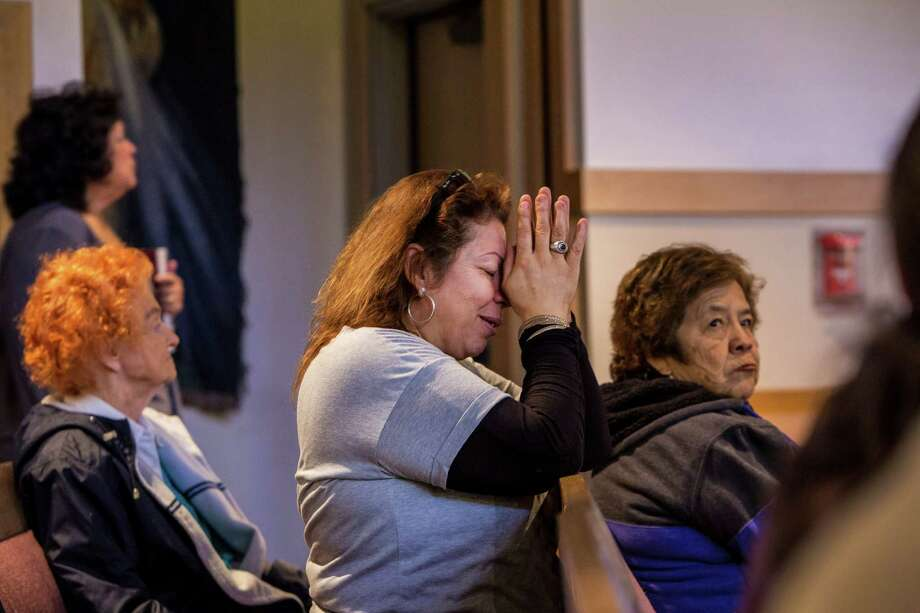 Letty Amaral prays during Mass at St. Catherine of Siena Catholic Church, which was attended by Yvette Velasco, who was killed in the San Bernardino mass shooting last week, in Rialto, Calif. In a community still reeling from an attack, many here spent the weekend trying to process the massacre that is being investigated by the FBI as inspired by the Islamic State. Photo: MONICA ALMEIDA /New York Times / NYTNS